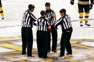 NHL officials huddle