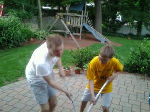 Ryan and C. playing hockey