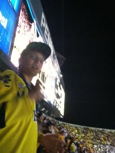 Ryan in front of the scoreboard